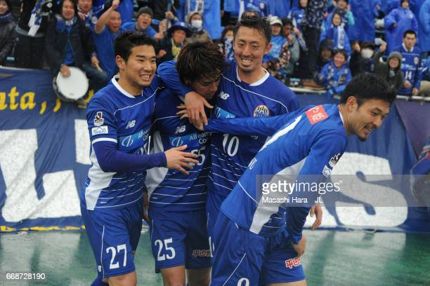 Koya Yuruki of Montedio Yamagata celebrates scoring the opening goal with his team mates during the JLeague J2 match between Montedio Yamagata and...