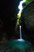 Beautiful Kozjak waterfall hidden in canyon near Kobarid in Slovenia, Triglav National Park.