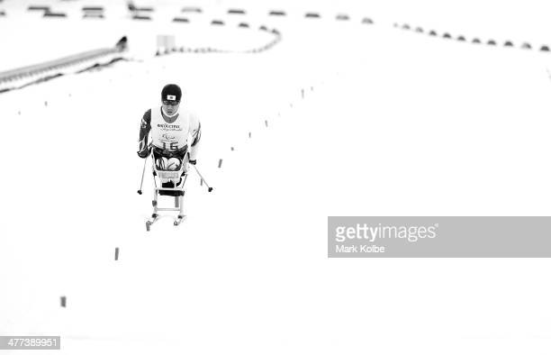 Kozo Kubo of Japan finishes in the men's 15km sitting crosscountry skiing during day two of Sochi 2014 Paralympic Winter Games at Laura Crosscountry...