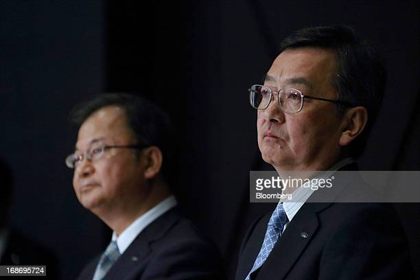 Kozo Takahashi incoming president of Sharp Corp right and Takashi Okuda incoming chairman attend a news conference in Tokyo Japan on Tuesday May 14...