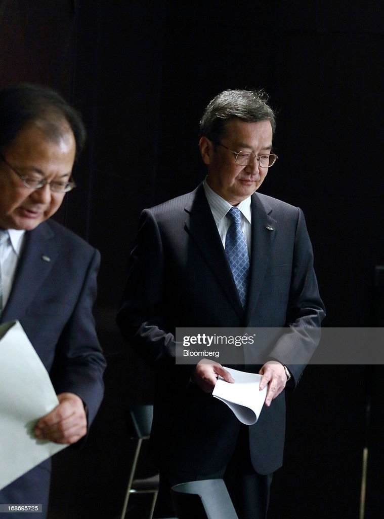 Kozo Takahashi, incoming president of Sharp Corp., right, and Takashi Okuda, incoming chairman, arrive for a news conference in Tokyo, Japan, on Tuesday, May 14, 2013. Sharp Corp. forecast its first annual profit in three years as Japan's largest maker of liquid-crystal displays expects orders to recover after signing a deal with Samsung Electronics Co. Photographer: Tomohiro Ohsumi/Bloomberg via Getty Images