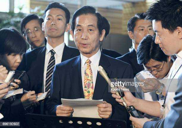 Kozo Yamamoto minister in charge of civil service reform speaks to reporters at the prime minister's office in Tokyo on June 15 after the government...