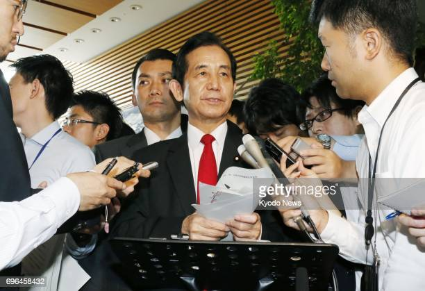 Kozo Yamamoto minister in charge of the Cabinet Office meets with reporters in Tokyo on June 16 2017 Yamamoto said the office staff did not make...