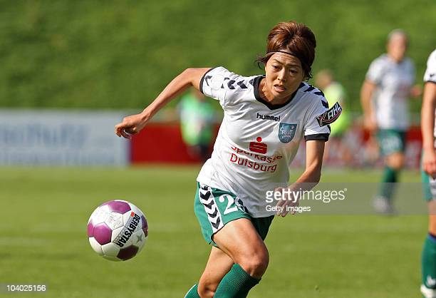 Kozue Ando of Duisburg runs with the ball during the Women's bundesliga match between FCR Duisburg and FFC Frankfurt at the PCCStadium on September...