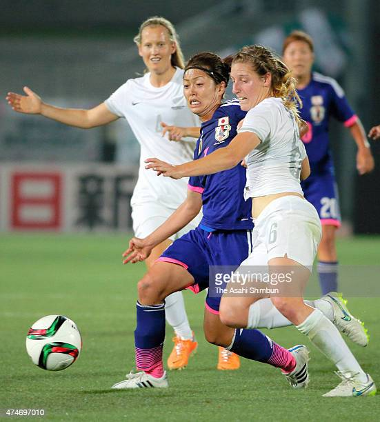 Kozue Ando of Japan and Rebekah Stott of New Zealand compete for the ball during the women's soccer international friendly match between Japan and...
