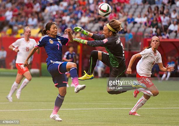 Kozue Ando of Japan is stopped by goalkeeper Gaelle Thalmann of Switzerland during the FIFA Women's World Cup Canada 2015 Group C match between Japan...