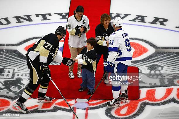 Kraft Hockeyville USA essayist for Johnstown Holly Lees and her grandson Bailey Quinn perform the ceremonial puck drop with Evgeni Malkin of the...