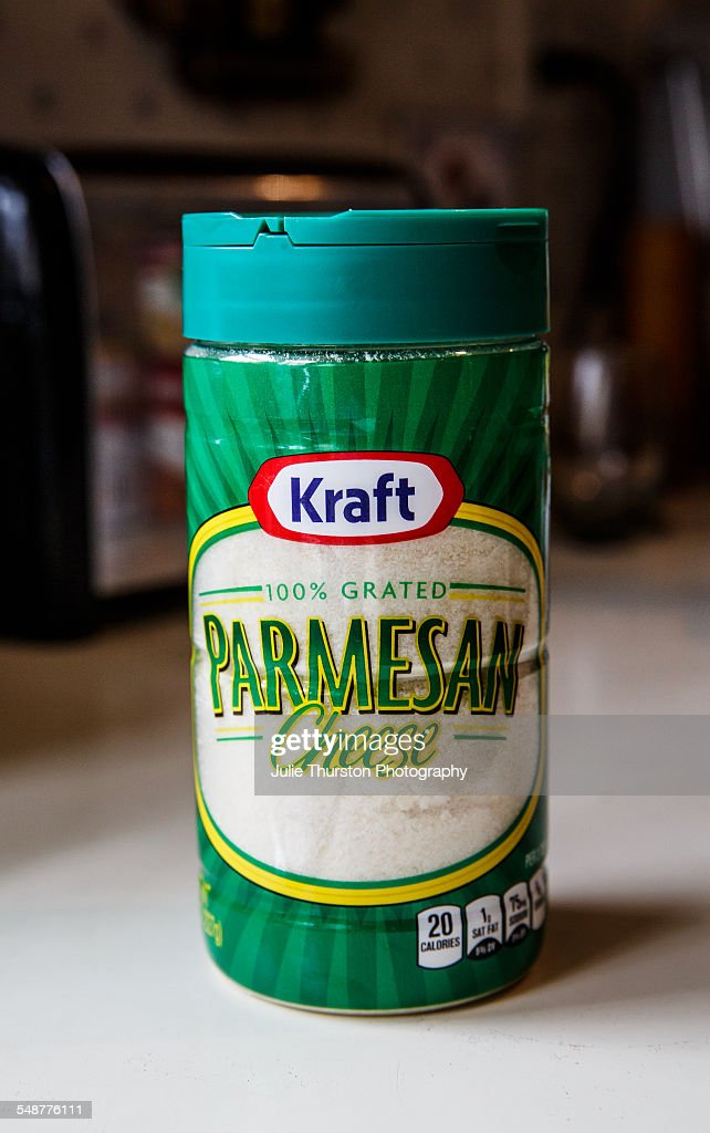 Kraft Parmesan Cheese brand in plastic shaker container Prepared 100% grated Parmesan cheese in green packaging ready to sprinkle on food dishes