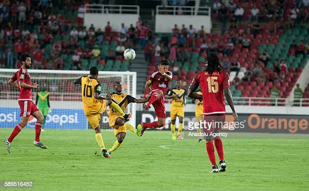 Krahire Yannick Zakri of ASEC and Anas Al Asbahi of Wydad Casablanca vie for the ball during the Group A match of CAF Champions League between Wydad...