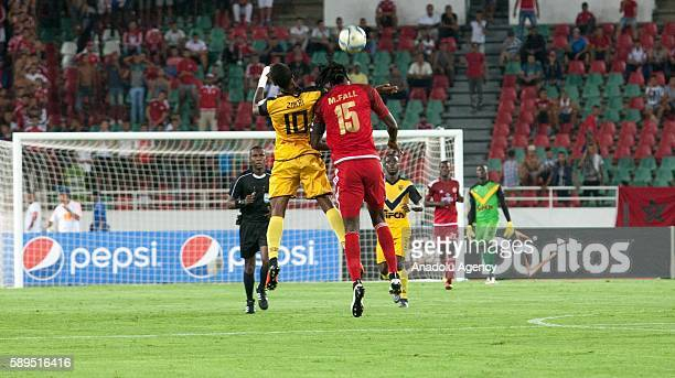 Krahire Yannick Zakri of ASEC and Mourtada Fall of Wydad Casablanca vie for the ball during the Group A match of CAF Champions League between Wydad...