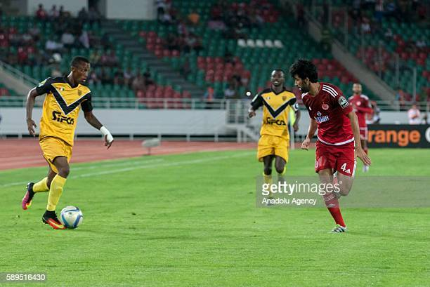Krahire Yannick Zakri of ASEC and Salaheddine Saidi of Wydad Casablanca vie for the ball during the Group A match of CAF Champions League between...