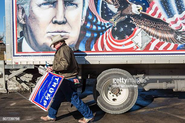 Kraig Moss a supporter of Republican presidential candidate Donald Trump outside a truck with a Trump painting in which he is touring Iowa on January...