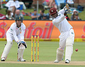 Kraigg Brathwaite drives a delivery during day 3 of the 2nd Test match between South Africa and West Indies at St Georges Park on December 28 2014 in...