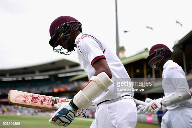 Kraigg Brathwaite of West Indies heads out to bat with team mate Shai Hope of West Indies during day one of the third Test match between Australia...