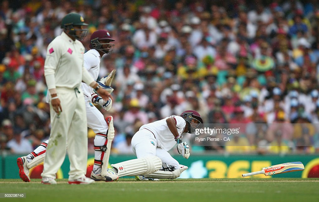 <a gi-track='captionPersonalityLinkClicked' href=/galleries/search?phrase=Kraigg+Brathwaite&family=editorial&specificpeople=6681140 ng-click='$event.stopPropagation()'>Kraigg Brathwaite</a> of West Indies slips over before <a gi-track='captionPersonalityLinkClicked' href=/galleries/search?phrase=Marlon+Samuels&family=editorial&specificpeople=185235 ng-click='$event.stopPropagation()'>Marlon Samuels</a> of West Indies is run out during day one of the third Test match between Australia and the West Indies at Sydney Cricket Ground on January 3, 2016 in Sydney, Australia.