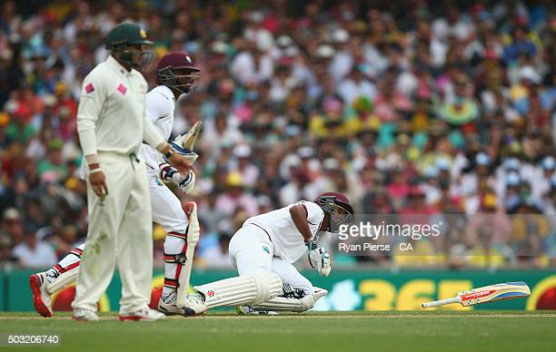 Kraigg Brathwaite of West Indies slips over before Marlon Samuels of West Indies is run out during day one of the third Test match between Australia...