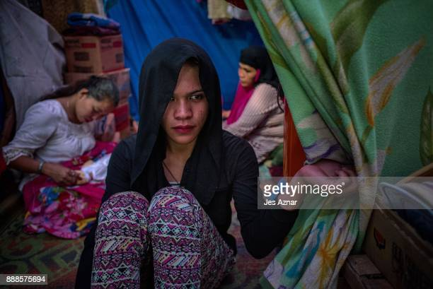 Krang inside a makeshift evacuation center where he lives with his family on November 24 2017 in Saguiaran southern Philippines As the battle between...