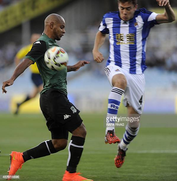 FC Krasnodar's Brazilian forward Ari vies with Real Sociedad's midfielder Gorka Elustondo during the UEFA Europa League playoffs football match Real...