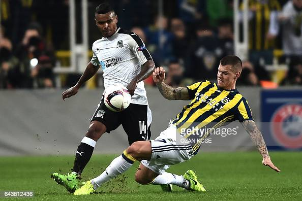 Krasnodar's Brazilian forward Wanderson vies for the ball with Fenerbahce's Slovak defender Martin Skrtel during the UEFA Europa League round of 32...