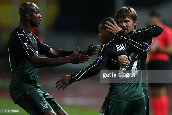 Krasnodar's Burkina Faso midfielder Charles Kabore Krasnodar's Brazil midfielder Joaozinho and Krasnodar's Russian midfielder Dmitri Torbinski...