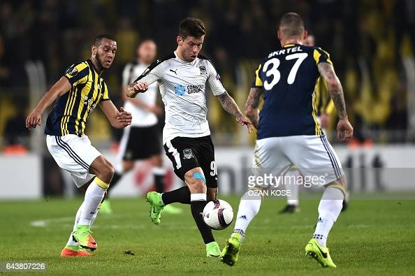 Krasnodar's Russian forward Fyodor Smolov vies for the ball with Fenerbahce's Brazilian midfielder Souza and Slovak defender Martin Skrtel during the...