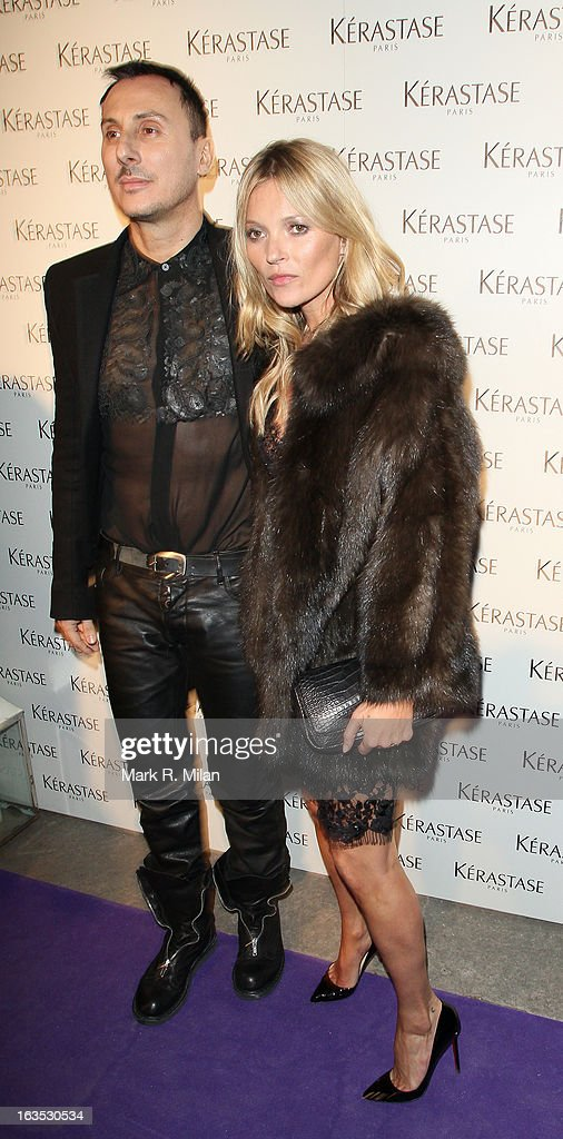 Kérastase's artistic director and studio hairdresser Luigi Murenu and Kate Moss at One Mayfair for the Kerastase launch event on March 11, 2013 in London, England.
