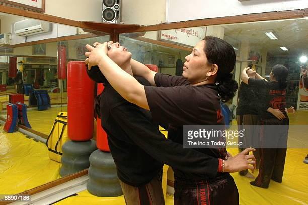 Krav Maga trainer Nirmala trains her client in New Delhi India