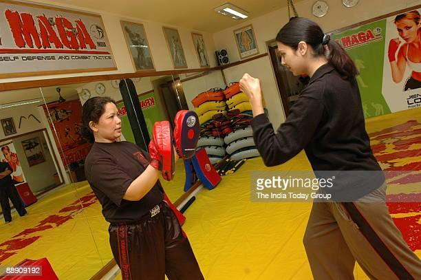 Krav Maga trainer Nirmala trains her client in New Delhi
