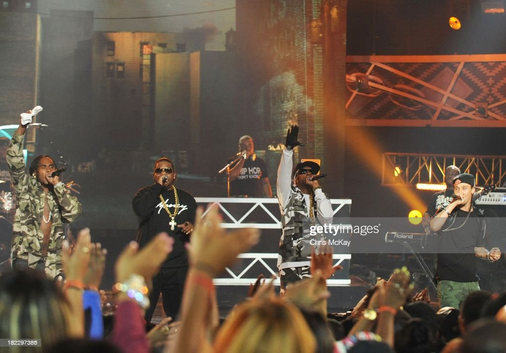 Krayzie Bone, Bizzy Bone, Wish Bone, and Flesh-N-Bone of Bone Thugs-N-Harmony perform during the BET Hip Hop Awards 2013 at the Boisfeuillet Jones Atlanta Civic Center on September 28, 2013 in Atlanta, Georgia.