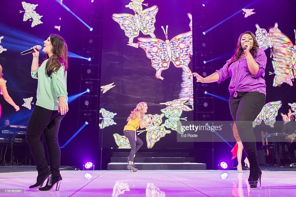 Kree Harrison and Candice Glover perform during American Idol Live! 2013 at Bridgestone Arena on August 31, 2013 in Nashville, Tennessee.