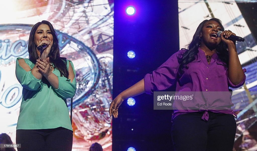 Kree Harrison and Candice Glover performs during American Idol Live! 2013 at Bridgestone Arena on August 31, 2013 in Nashville, Tennessee.