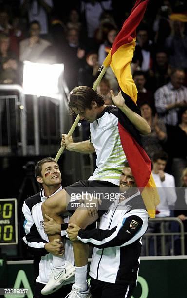 Germany's Tommy Haas celebrates with his teammates Alexander Waske and Michael Kohlmann after defeating Croatia's Ivan Ljubicic in their Davis cup...