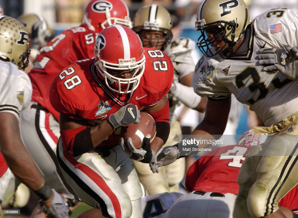 Kregg Lumpkin of the Georgia Bulldogs rushes against Pat Kohtz of the Purdue Boilermakers on January 1 2004 during the Capital One Bowl at Florida...