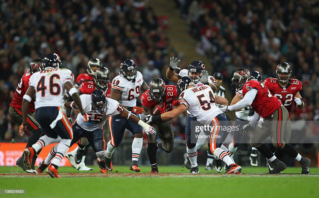 Kregg Lumpkin #28 of the Tampa Bay Buccaneers attempts to break through the Chicago Bears defense during the NFL International Series match between Chicago Bears and Tampa Bay Buccaneers at Wembley Stadium on October 23, 2011 in London, England. This is the fifth occasion where a regular season NFL match has been played in London.