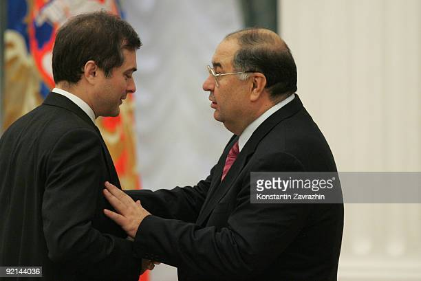 Kremlin's main ideologist Vladislav Surkov and Russian billionaire Alisher Usmanov speak prior to attending a meeting with other business leaders and...
