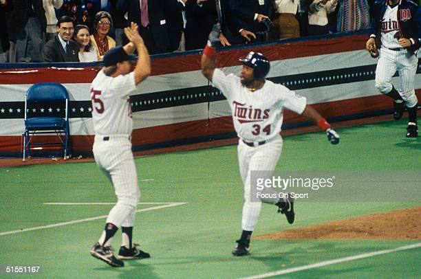 Kriby Puckett of the Minnesota Twins celebrates after hitting a home run in the eleventh inning against the Atlanta Braves during Game 6 of the 1991...