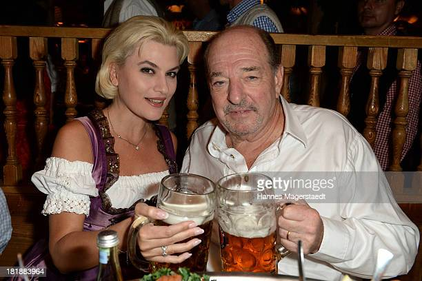 Kriemhild JahnSiegel and Ralph Siegel attend the Oktoberfest beer festival at the Kaefer tent on September 25 2013 in Munich Germany