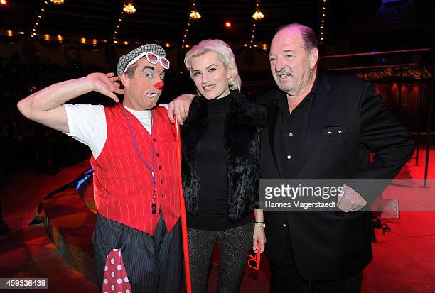 Kriemhild JahnSiegel Ralph Siegel and clown Charlie attend the Circus Krone Christmas Show at Circus Krone on December 25 2013 in Munich Germany