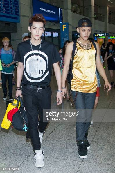 Kris and Tao of boy band EXOM are seen upon arrival at Incheon International Airport on June 24 2013 in Incheon South Korea
