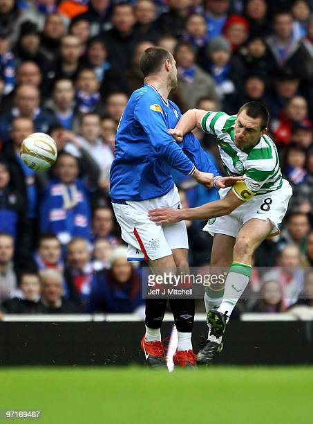 Kris Boyd of Rangers tackles Scott Brown of Celtic during the Scottish Premier League match between Rangers and Celtic at Ibrox stadium on February...