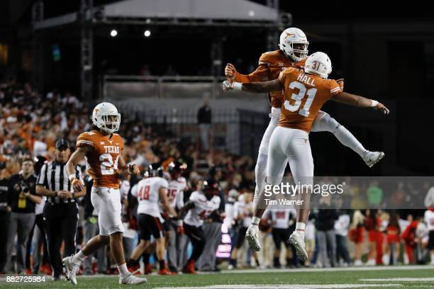 Kris Boyd of the Texas Longhorns celebrates with Jason Hall of the Texas Longhorns after breaking up a pass in the second quarter against the Texas...