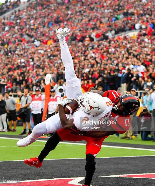 Kris Boyd of the Texas Longhorns intercepts a pass intended for Cameron Batson of the Texas Tech Red Raiders during the game on November 5 2016 at...