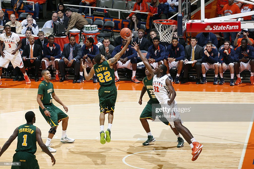 Kris Brown #22 of the Norfolk State Spartans rebounds against Nnanna Egwu #32 of the Illinois Fighting Illini during the game at Assembly Hall on December 11, 2012 in Champaign, Illinois. Illinois won 64-54.