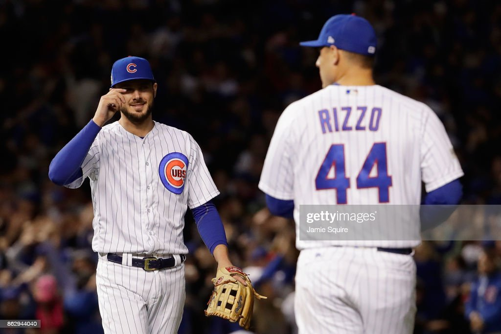 Kris Bryant #17 and Anthony Rizzo #44 of the Chicago Cubs celebrate after beating the Los Angeles Dodgers 3-2 in game four of the National League Championship Series at Wrigley Field on October 18, 2017 in Chicago, Illinois.