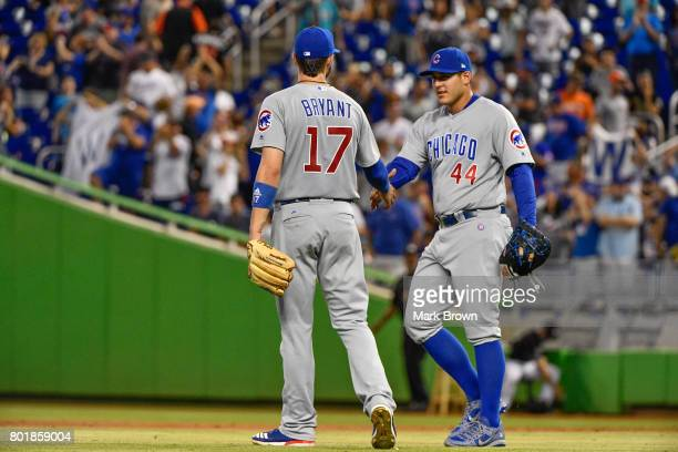 Kris Bryant and Anthony Rizzo of the Chicago Cubs in action during the game between the Miami Marlins and the Chicago Cubs at Marlins Park on June 24...