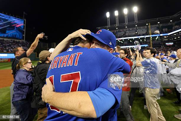 Kris Bryant and David Ross of the Chicago Cubs celebrate on the field after defeating the Cleveland Indians in Game 7 of the 2016 World Series at...