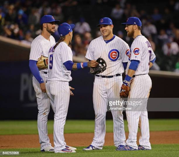 Kris Bryant Javier Baez Anthony Rizzo and Ben Zobrist of the Chicago Cubs chat during a 9th inning pitching change against the New York Mets at...