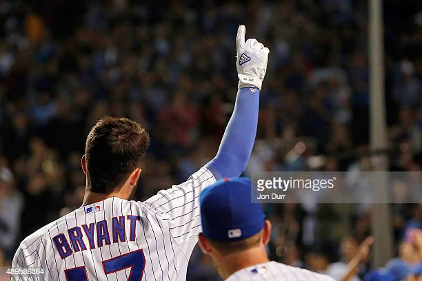 Kris Bryant of the Chicago Cubs acknowledges the crowd after hitting a tworun home run against the Milwaukee Brewers during the third inning at...