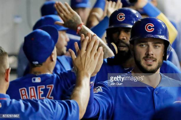 Kris Bryant of the Chicago Cubs and Jason Heyward are congratulated in the dugout after scoring against the Chicago White Sox on a three run RBI...