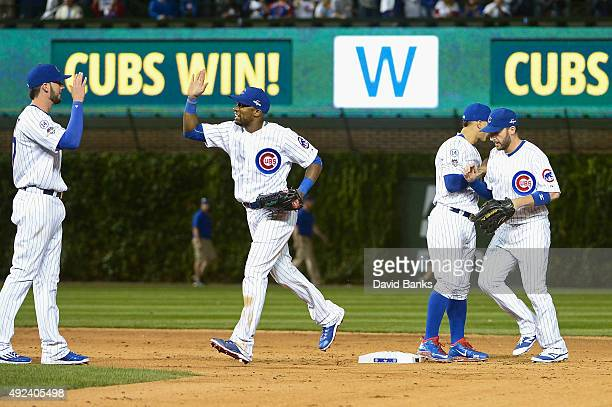 Kris Bryant of the Chicago Cubs Austin Jackson of the Chicago Cubs Javier Baez of the Chicago Cubs and Chris Denorfia of the Chicago Cubs celebrate...